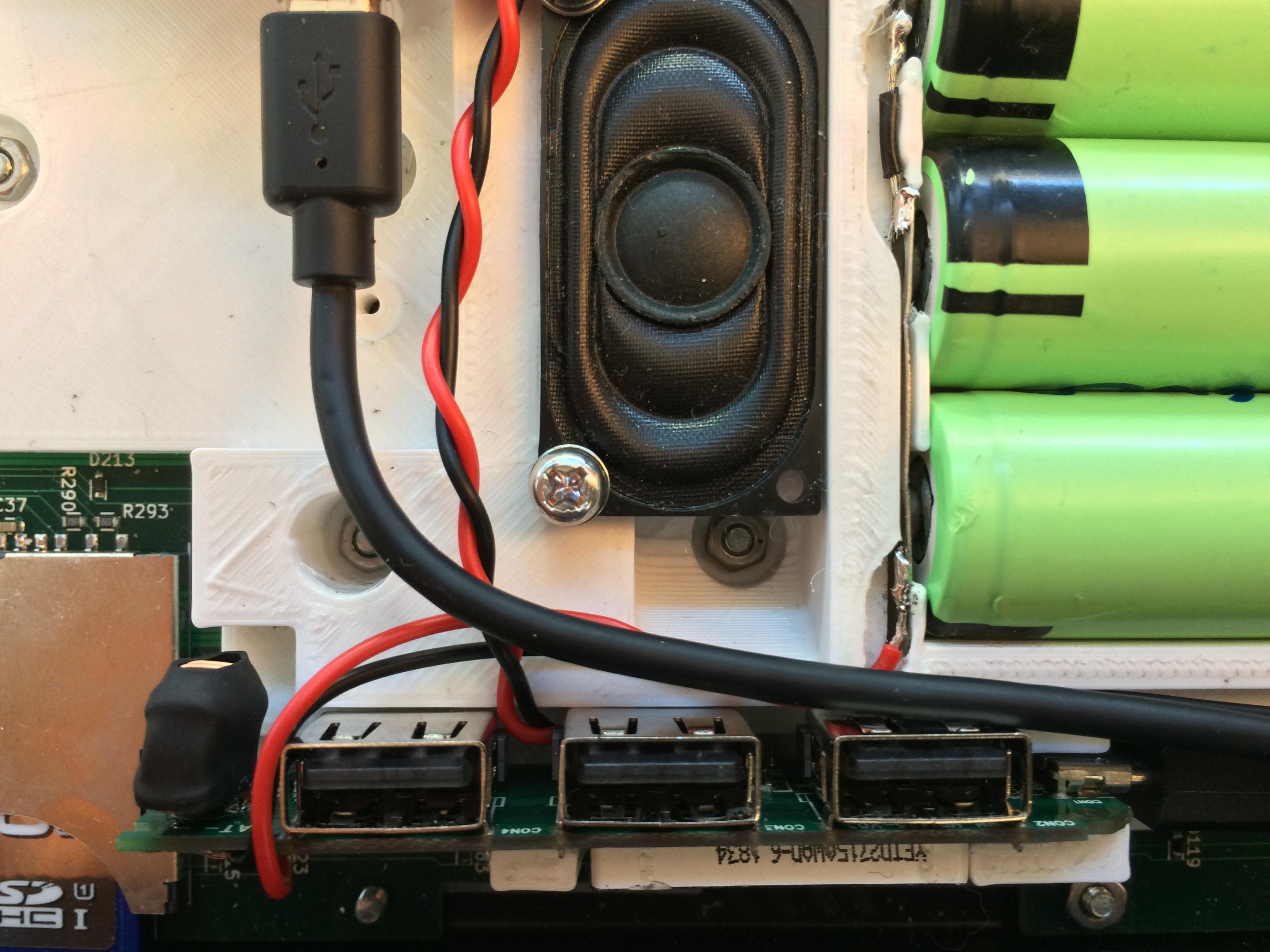 Speaker mounted, reflex port below